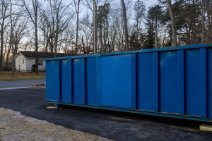 Construction,Trash,Dumpsters,On,Metal,Container,,House,Renovation.