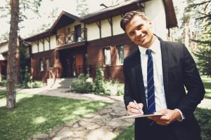 Cheerful,Confident,Young,Realtor,Standing,With,His,Notes,In,Front